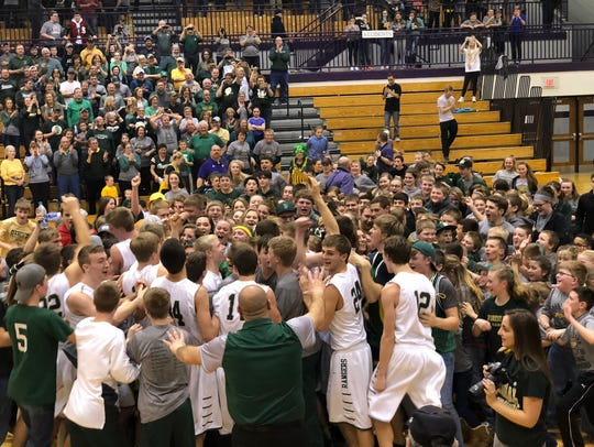 Forest Park students celebrate after the boys' basketball