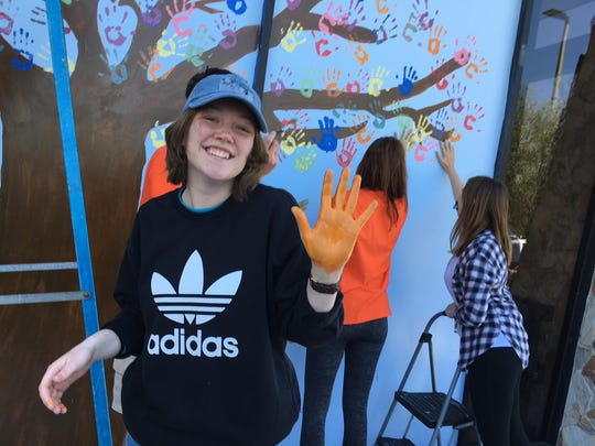 Up with People volunteers paint a mural in front of The Children's Hunger Project in Cocoa. They spent the first part of the day packing food for the project. Up with People perform this weekend at Eau Gallie High School Auditorium. For tickets, visit www.UpwithPeople.org/BrevardCounty