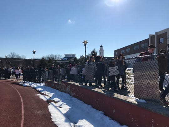 Students at Highland Park High School walking out of class Wednesday morning as part of a nationwide student protest calling for gun control in the wake of the Parkland school shooting one month ago.