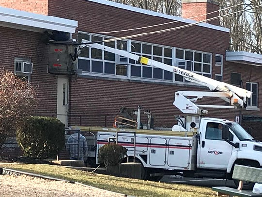 Workers for Verizon were doing work at the Indiana Avenue School #18 in the Iselin section of Woodbridge on Thursday.