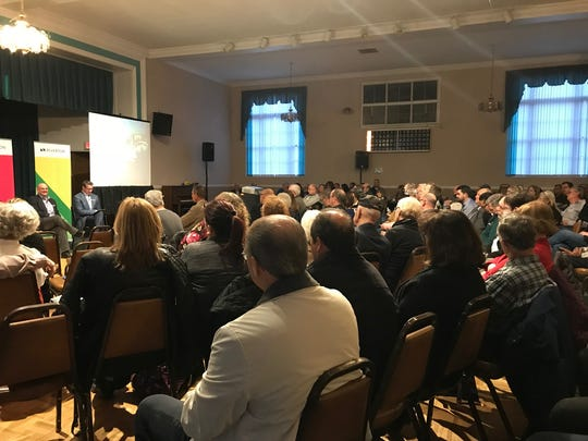 More than 300 people packed the Sayreville Senior Center to hear about the 418-acre project planned, Riverton, on the Raritan River.