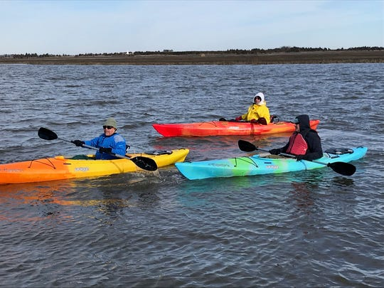Steve Nieblas, Len Leshem and Tom Thaler (from left to right) bundle up and grab their paddles to raise money for Special Olympics Delaware.
