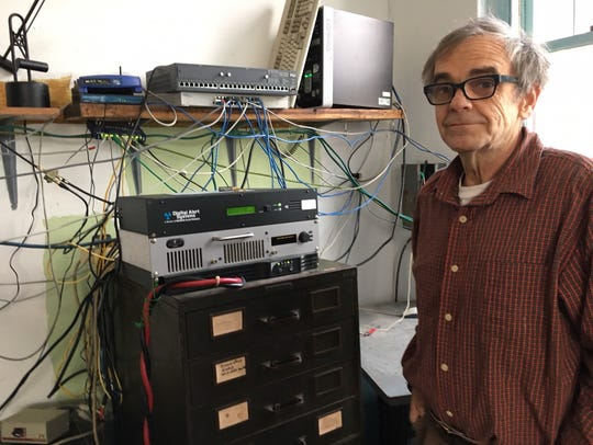 John Tinker shows some of the massive electronics work he has done with most discarded equipment to power a community radio station in Fayette, Missouri.