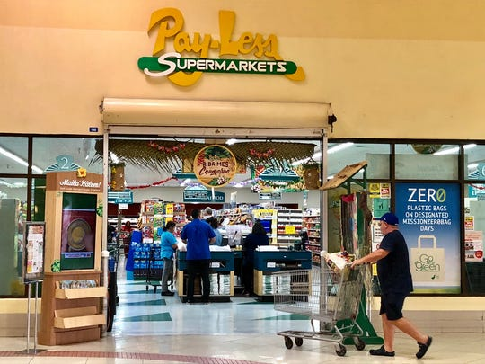 A shopper about to go into Pay-Less Supermarket at the Agana Shopping Center in this file photo. The Agana Pay-Less will be closed for business on Aug. 5.