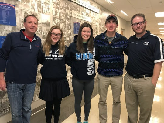 With Mount Notre Dame state champion diver Teagan Moravek, middle, are club coach Kevin McElheney, fellow state diver Grace Menke, state DII diving champion Noah Vigran and Mount Notre Dame coach Brandon Unthank.
