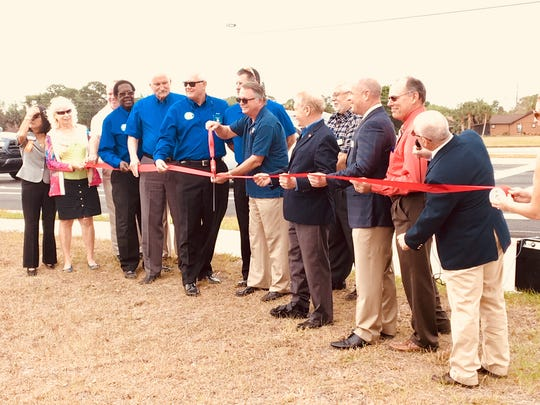 Officials cut the ceremonial red ribbon on Thursday,