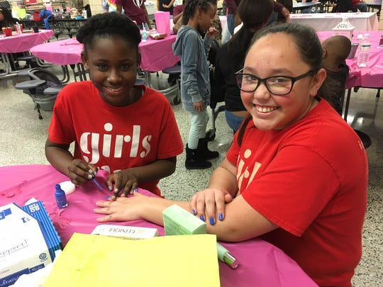 "Alaysia Wright does Itzel Flores' nails. When asked, ""are you buddies?"" both girls giggle and answer, ""yes!"""