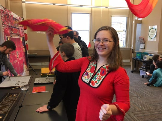 "Mia Varner twirls a Chinese ""finger hula hoop."" The sophomore, who takes classes in the Mandarin language, also demonstrated Chinese calligraphy."