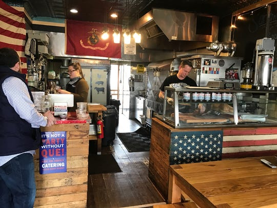 The open kitchen of Red White & Que Smokehouse in Kearny.