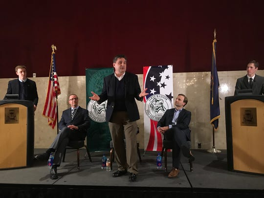 Three GOP candidates for governor: Sen. Patrick Colbeck (center); Dr. Jim HInes (seated left); and Lieutenant Gov. Brian Calley (seated right) took part in a town hall meeting at MSU on April 3.