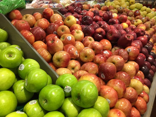 A display of apples in the produce section of Fresh