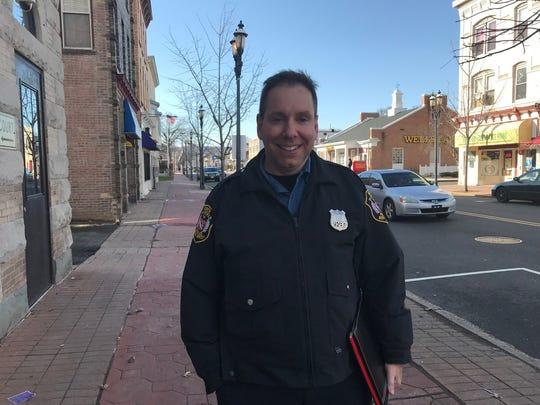 North Plainfield Detective Albert Domizi on his walking patrol Wednesday on Somerset Street.