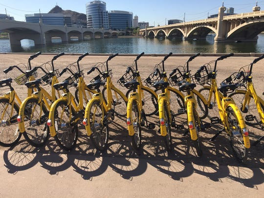 Dockless Ofo bikes parked along Tempe Town Lake, pictured on April 4, 2018.