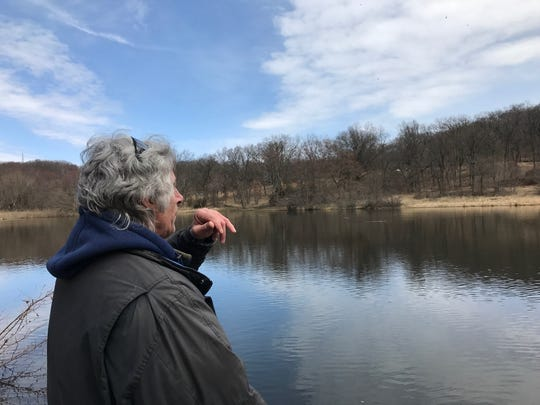 Jeff Nieradka of Clifton says he's fished Barbour's Pond so many times that he's caught the same fish twice. Here, he looks toward a spot across the pond where a 15-pound Rainbow Trout lives.