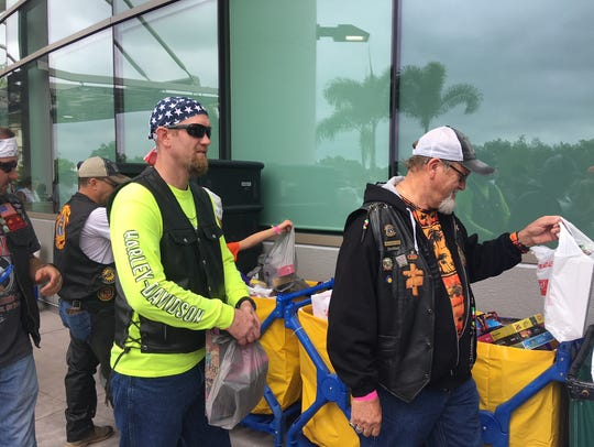 Members of Harley Owners Group (HOG) deliver presents