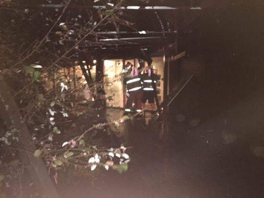 Mountain Home firefighters examine damage to Hiram