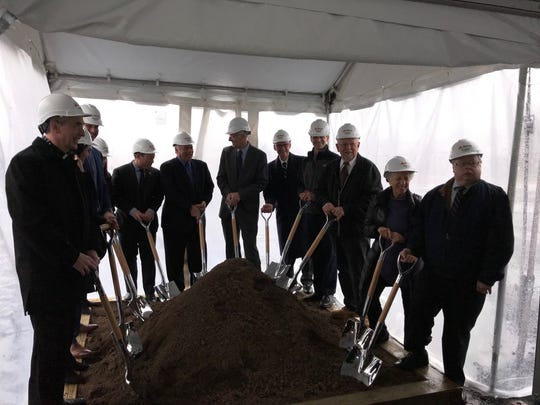 Dignitaries line up to dig ceremonial dirt during a ground-breaking for the Wyckoff ShopRite on Monday.