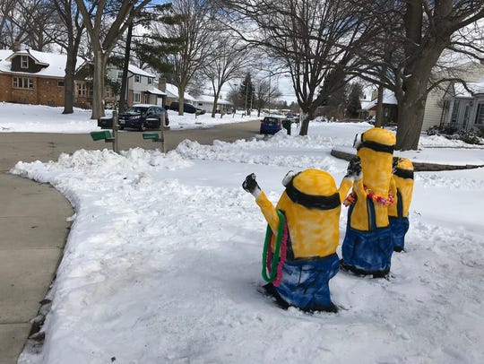 A trio of minions wave a happy hello to the neighborhood