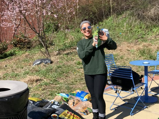 Dana Gutierrez, an AmeriCorps volunteer from Nutley, pitching in at the cleanup at William Carlos Williams Community Plaza.