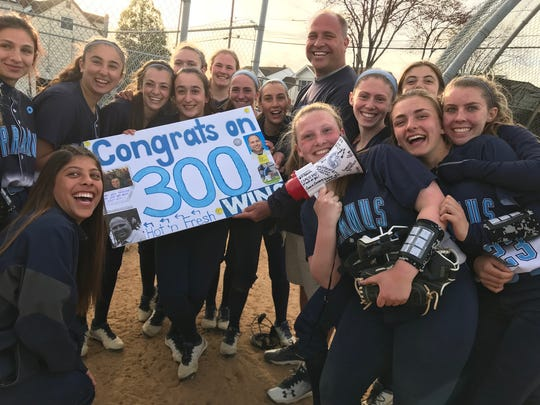 Paramus softball coach Brian Hay celebrates his 300th