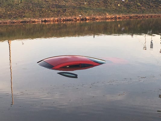 636599067448794549-Car-in-pond.jpg