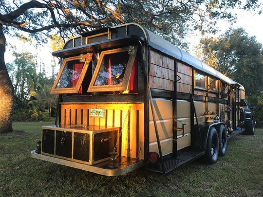 One of eight projects and counting by Naples landscape architect David Carlyle of Naples, who turns horse trailers into portable tiny homes that look like Victorian-era train cars.