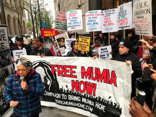 Supporters of Mumia Abu-Jamal, convicted in the 1981 murder of white Philadelphia police Officer Daniel Faulkner, gather outside the Criminal Justice Center in Center City Philadelphia on Monday, April 30, 2018. Former death-row inmate Abu-Jamal is in court asking a judge to vacate his previous failed appeals attempts, so he can again appeal his case.
