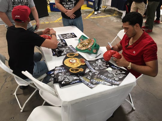 Jose Benavidez Jr. (left) and David Benavidez sign