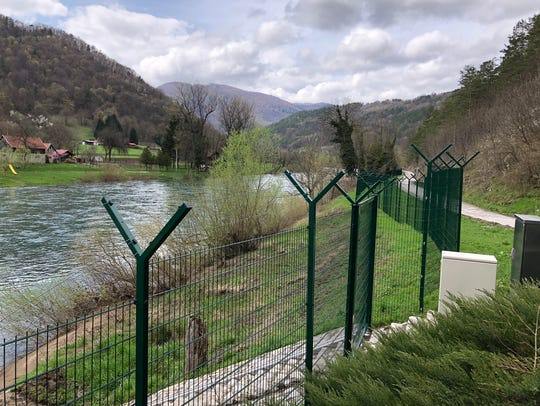 A border fence separates Slovenia and Croatia, seen from the Slovenian side, on April 10, 2018.