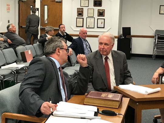 Traffic engineer Paul Goin consults with Wawa attorney Thomas Herten during Tuesday's conclusion of testimony on a proposed store and filling station in Oakland