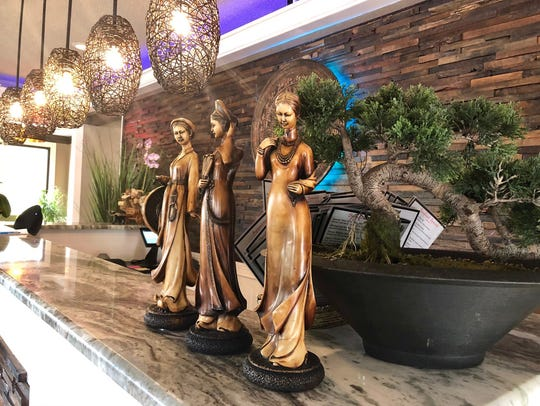 Vietnamese wood carvings at the front counter of Viet