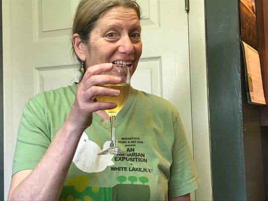 Teresa Maltz raises a glass of Carol Bergman's flavored kombucha. Methods of preserving sustainability and wasting less in terms of food have become more than trendy and retro actions of the millennial generation. Preserving, composting and fermenting are some of the ways to save and re-purpose food from the refrigerator and garden that hearken back generations.