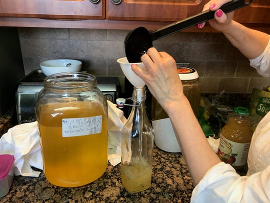 Carol Bergman of Old Bridge prepares the next batch of kombucha she makes at her home. Methods of preserving sustainability and wasting less in terms of food have become more than trendy and retro actions of the millennial generation. Preserving, composting and fermenting are some of the ways to save and re-purpose food from the refrigerator and garden that hearken back generations.