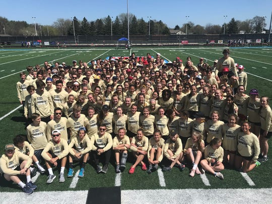 Members of the Arrowhead boys and girls track teams are shown here wearing gold shirts to support Kalena Clauer in her fight against cancer.
