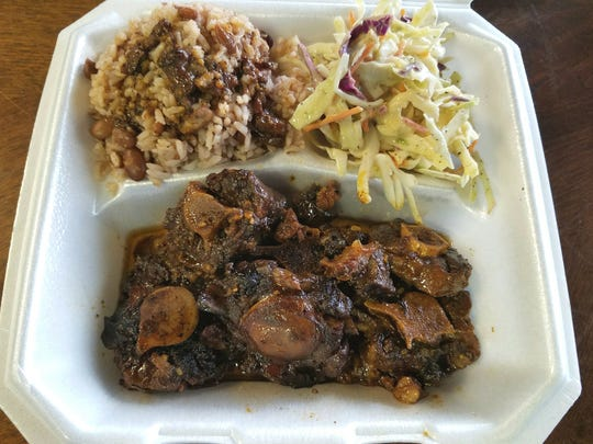 Smiling Flavors Caribbean Jerk's oxtail is meat from