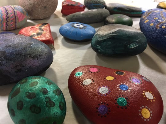 Students at Northcentral Technical College's Alternative High School painted rocks for the community to find May 19 at Monk Botanical Gardens.