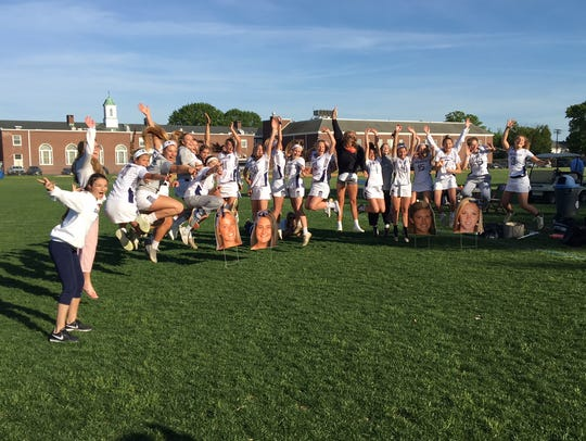 The Manasquan girls lacrosse team jumps for joy after