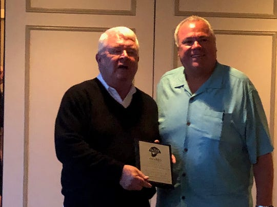 Steve Bidgood (right), owner of Salt Creek Grille, accepted the award from Jim Flynn, chairman of Shorefoodie.com.