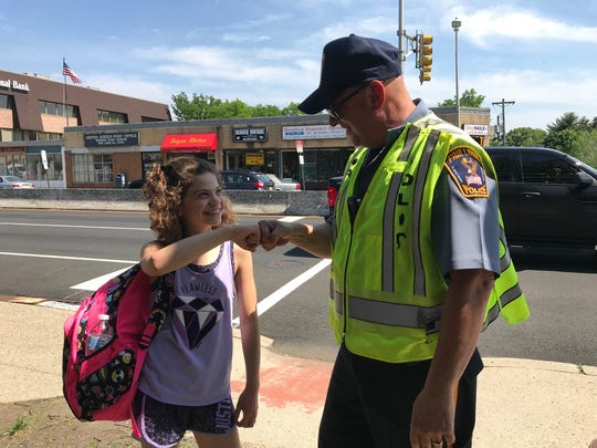 Officer Lou Failla with Sofia Gugliotta, a student at Warren Point Elementary School