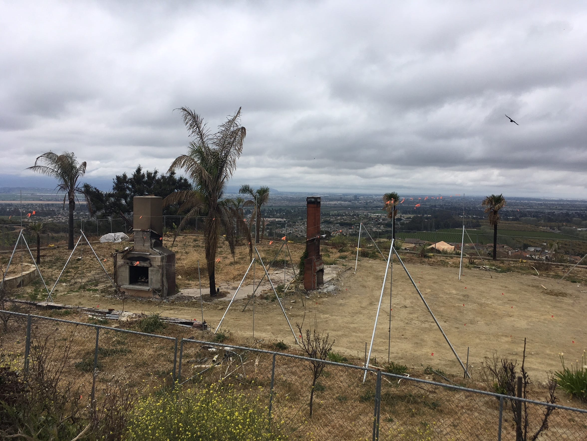 Story poles show the proposed height of a rebuilt home in Ventura. The former house burned in the Thomas Fire.