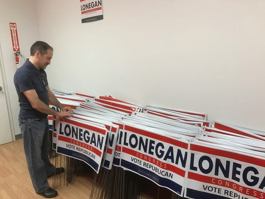 Mike Proto, Steve Lonegan's campaign manager, checking