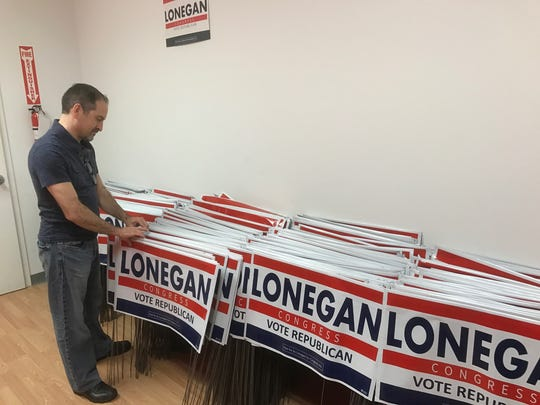 Mike Proto, Steve Lonegan's campaign manager, checking the signs at headquarters in Washington Township.