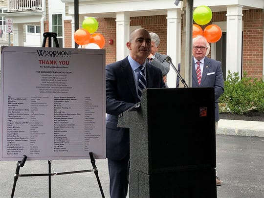 Woodmont Properties President Lewis Zlotnick spoke at the ribbon cutting at Woodmont Cove in South Amboy on Thursday.