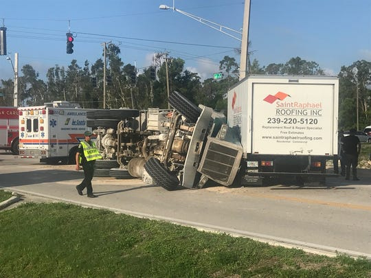 A dump truck turning onto Lee Road from Alico Road overturned, blocking Lee shortly before 8 .m. Monday. The dump truck driver received minor injuries.