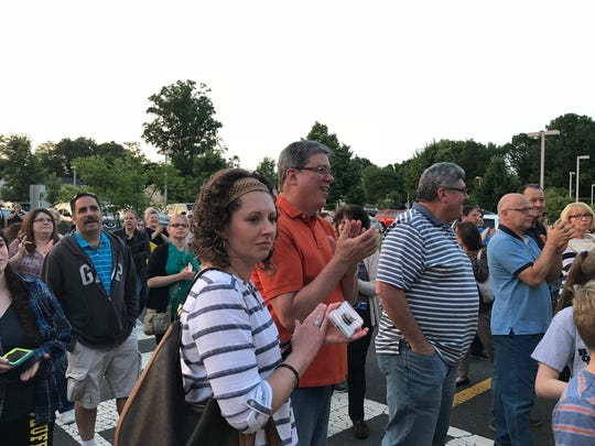 A crowd listened to SaveFrost.com speakers Thursday evening after  the East Brunswick Zoning Board of Adjustment hearing for a controversial planned project was postponed.