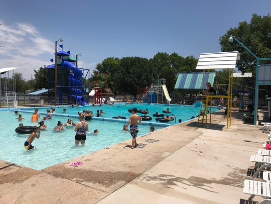 Swimmers cool off in the water on June 8, 2018 at Brown's