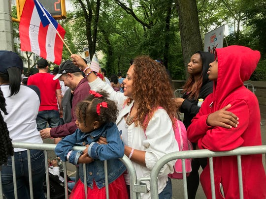 Magalye Matos of Englewood attends the Puerto Rican Day Parade in New York City with her daughter, London, 3, and son Christopher, 13.