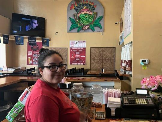 Waitress Mercedes Ledezma works at the Iguana Cafe