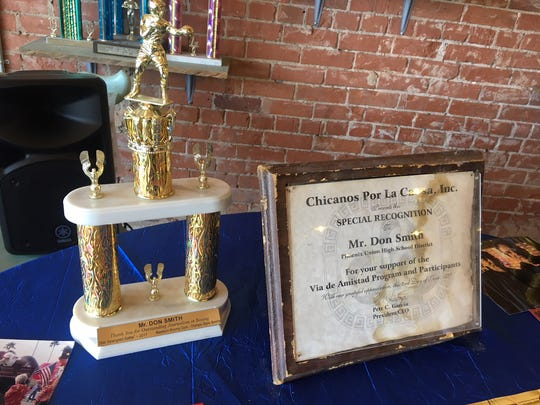Trophies and mementos sit at a table at Don Smith's memorial at Sonny's Boxing Gym in Goodyear on June 2.