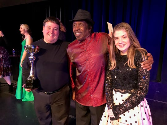 William Reed, left, poses with third-place winner Carl Garvin and runnerup Alyvia Colvin after results of the 2018 Abilene Idol competition were announced last year.